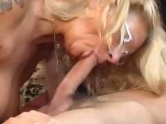Foreplay with the tattooed mature in glasses