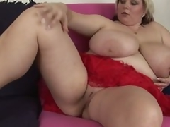 Bulky mature blond Juliana shows it all