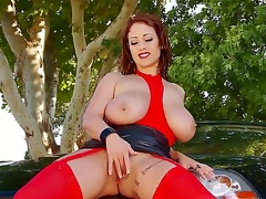Eva Notty might be not quite 60-years-old in this scene, but her youthful face and 34J-28-34 measurements give her the look of a redhead,  Amazonian Goddess much, much younger.