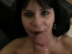 Slutty dark haired and sexy honey Naomi A sucks and licks Rocco Siffredis weenie on the bed and gets sprayed with cum all over her face after doing the job right