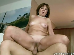 Marsha is a sex hungry granny who can not acquire enough. Fully nude mature bitch bounces up and down on wang in the indoor swimming pool. She takes young guys unbending dick so unfathomable in her love tunnel