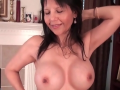 Sexy mature caresses her big fake tits lustily
