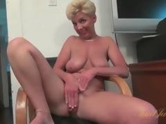 Busty solo mature masturbates hairless pussy