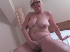 In nature's garb old sweetheart masturbates her hairy cunt