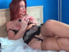 Aged redhead models lingerie and masturbates