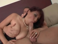 Sexy milf in tight corset gives a great titjob