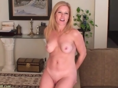 Glamorous golden-haired milf models her perky zeppelins for us