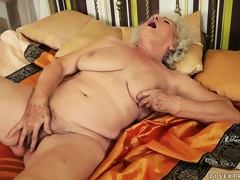 Afternoon delight with plumper granny toying her very curly bush