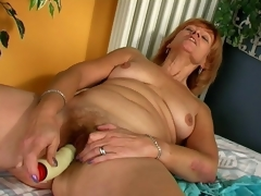 Lustful redhead granny Lady licking a giant dildo with lust