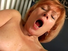 Charming granny Lady widens pussy and copulates a massive white dildo