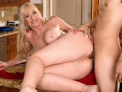 For her first on-camera fuck anywhere, 59-year-old Summeran Winters reenacts one of our favorite scenarios: MILF seduces the delivery boy. Now, if youve ever been a delivery boy, you know this kind of thing happens all the time. Real-life MILFs indeed do tempt the delivery boy, whether its the pizza fellow or the supermarket guy.The thing is, though, usually, the delivery boy is on the receiving end of the most good blow job of his life. In uncommon instances, this guy gets some vagina to fuck. But how often does this guy acquire to fuck the MILF in the ass? Almost never, which is what makes this scene so special. That and the fact that this guy gets to fuck Summeran in the wazoo on the kitchen table.In my personal life, I love anal sex, so why wouldnt I desire to have anal sex my first time in front of the camera, Summeran said. Some people make a large deal out of anal sex, but to me, whats the difference between me having a ramrod in my vagina or a ramrod in my ass?By our estimate, a few inches, at most.