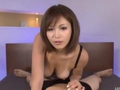 Sexy tanned Mai Kuroki up bed playing with a scalding guys cock making him cum