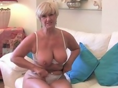 Blonde granny plays with the brush fur pie