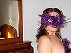Bulky Spanish mature woman in cute bra with multicolor heart shaped patterns blows dong wearing a extraordinary violet feather mask and listening to Santana's rendition of 'Black Magic Woman'.